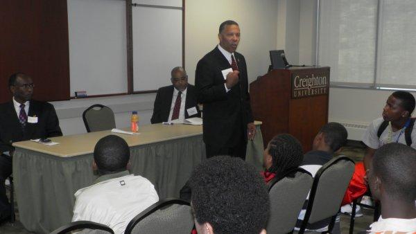 Bill Alexander John Ewing Jr with YMMI Creighton